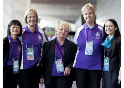 Volunteers with their accreditation passes